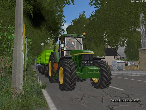 John Deere 7810 beim Getreide fahren