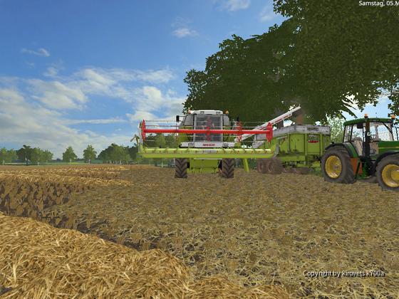 John Deere 7710 und Clase Mega im Einsatz bei der Ernte